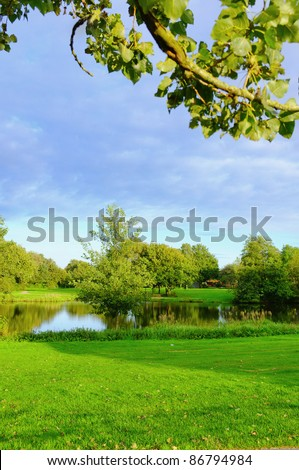 A photo of public park with lake - stock photo