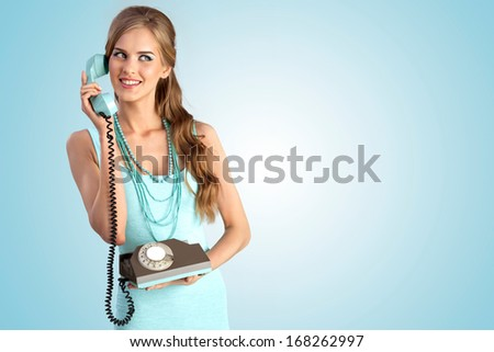 A photo of the smiling girl with vintage phone. - stock photo