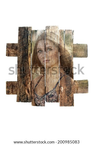 A photograph of a pretty girl outdoors, overlaid on real aged and weathered wood.  Generous copyspace. - stock photo