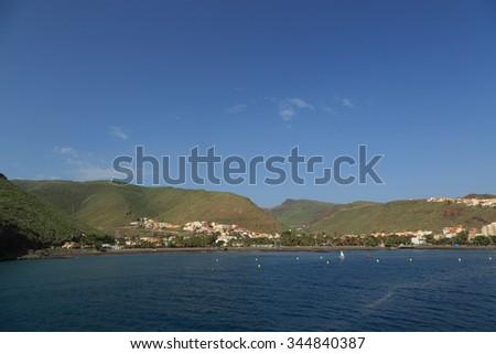 A photograph of San Sebastian de La Gomera, Canary Islands, Spain. San Sebastian de la Gomera is a town (the main port and capital) and a municipality on La Gomera in the Canary Islands, Spain.  - stock photo