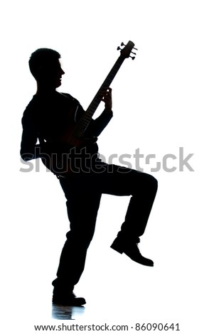 A photographic silhouette of a Guitar Player - stock photo