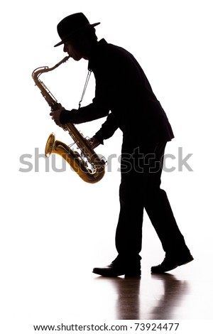 A photographic silhouette of a saxophone player into the moment - stock photo