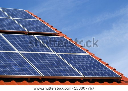 a photovoltaic power plant on a roof - stock photo