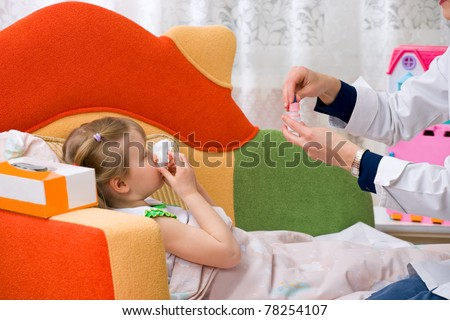 A physician house call. Doctor giving nose drops to sick girl - stock photo