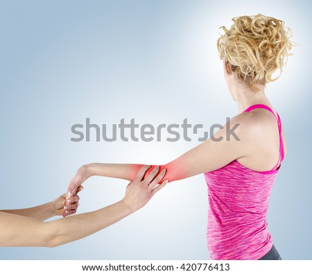 A physio gives myotherapy using trigger points on athlete woman. - stock photo
