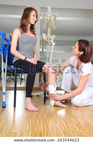 A Physiotherapist and patient with knuckle injury  - stock photo
