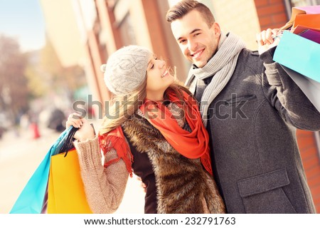 A picture of a beautiful couple shopping together in the city - stock photo
