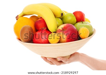 A picture of a bowl of fruits over white background - stock photo