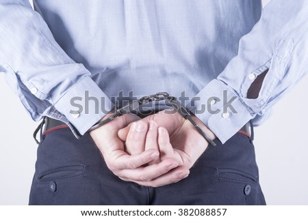 a picture of a businessman locked in handcuffs - stock photo