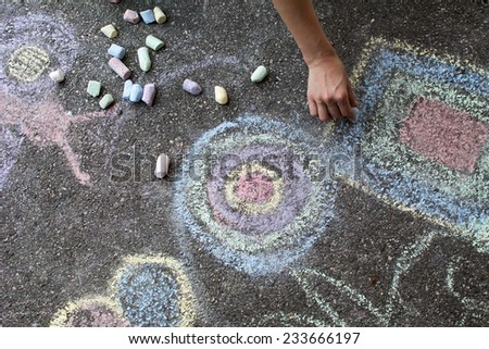 A picture of a childhood, woman paints some shapes... - stock photo