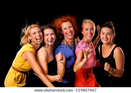 A picture of a group of friends dancing over black background - stock photo