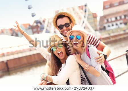 A picture of a group of friends hanging out in the city - stock photo