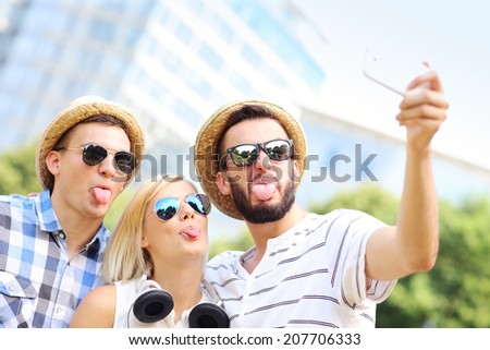 A picture of a group of friends taking a picture in the park - stock photo