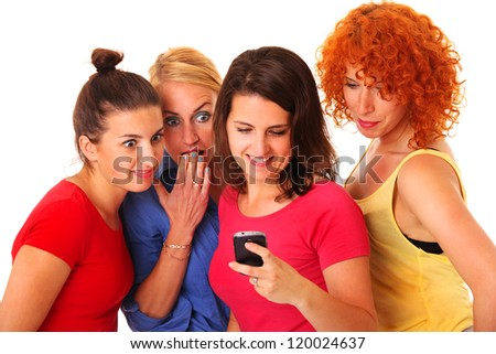 A picture of a group of friends using a cellphone over white background - stock photo