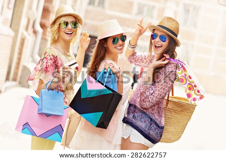 A picture of a group of happy friends shopping in the city - stock photo