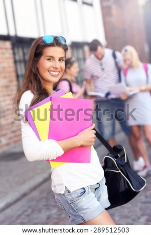 A picture of a group of happy students studying outdoors - stock photo