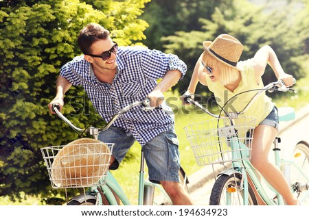 A picture of a happy couple spending free time on bikes in the city - stock photo