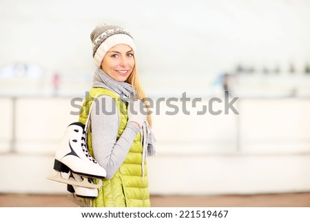 A picture of a happy woman on the ice rink - stock photo