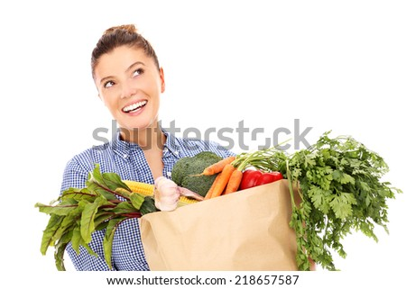 A picture of a happy woman with vegetables over white background - stock photo