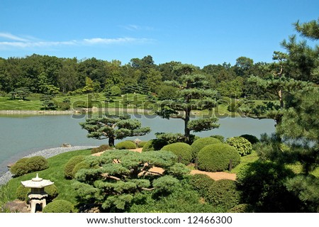 A picture of a japanese gasrden with bonsai trees and pond - stock photo