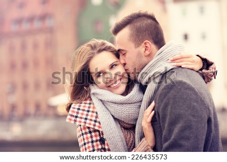 A picture of a man kissing a woman on a date in Gdansk - stock photo