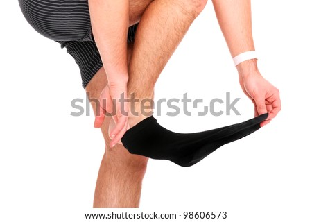 A picture of a man taking off his socks over white background - stock photo