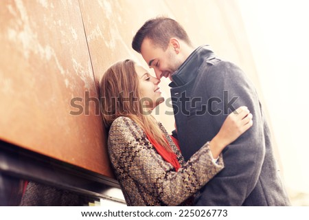 A picture of a romantic couple kissing on an autumn date - stock photo