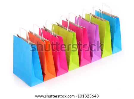 A picture of a row of colorful shopping bags over white background - stock photo