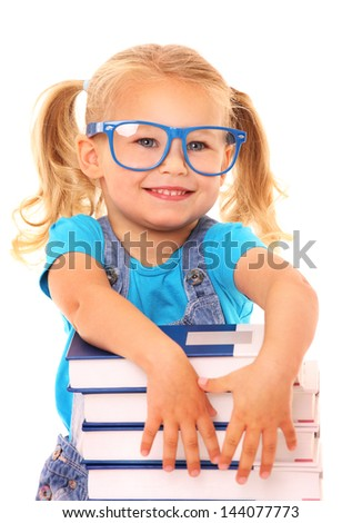 A picture of a young cheerful girl resting her arms on the pile of books against white background - stock photo