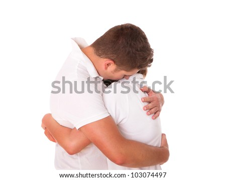 A picture of a young couple hugging over white background - stock photo