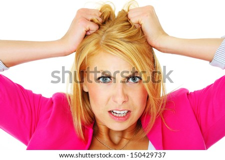 A picture of a young depressed woman tearing out her hair over white background - stock photo