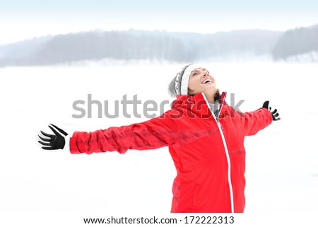 A picture of a young pretty woman having fun in the winter forest - stock photo