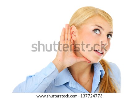 A picture of a young woman listening with attention over white background - stock photo