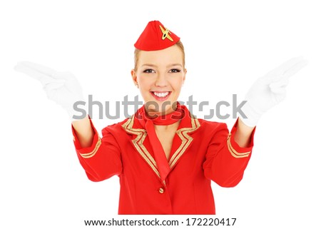 A picture of an attractive stewardess showing emergency exits over white background - stock photo