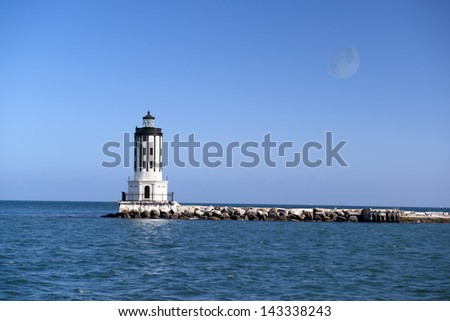 A picture of Angels Gate lighthouse on the breakwater in San Pedro California. - stock photo