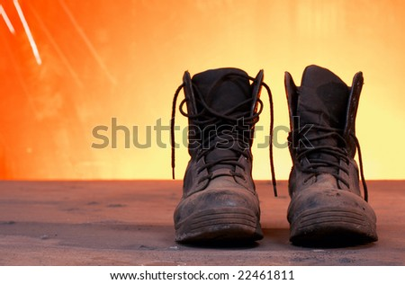 a picture of black work boots on a steel table - stock photo