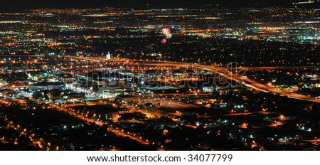 A picture of downtown Salt Lake City, UT at night with fireworks. - stock photo