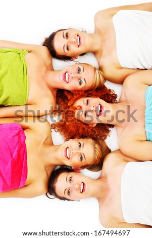 A picture of five girl friends having fun in spa over white background - stock photo