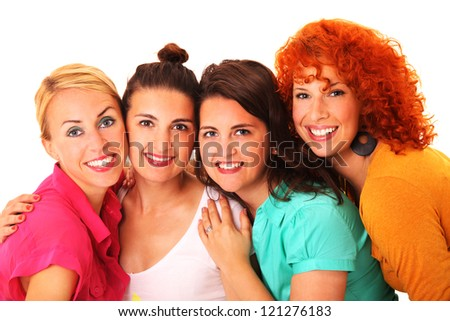 A picture of four beautiful girls standing and smiling over white background - stock photo