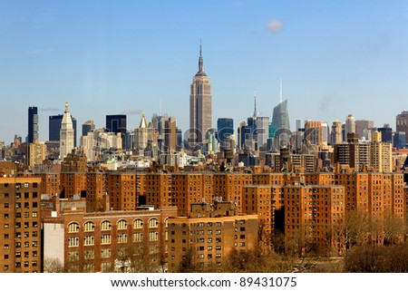 A picture of New York City, NY, USA, featuring the skyline of midtown with the famous Empire State Building in the center. - stock photo