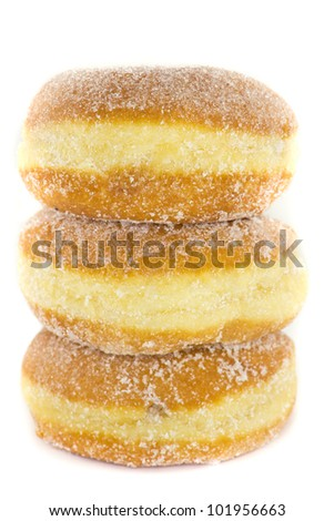 A picture of three jelly donuts stacked on top of each other - stock photo