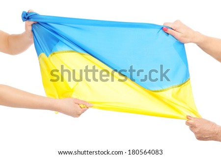 A picture of two people fighting for a Ukrainian flag over white background - stock photo