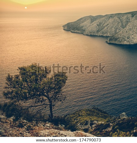A picturesque sunset view at Kampi, Zakynthos island, Greece - vintage coaster - stock photo