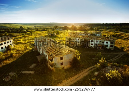 A picturesque view of a ruined buildings at  sunrise  time. - stock photo