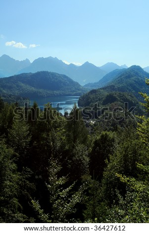 A picturesque view of Alpine moutains and forests. - stock photo