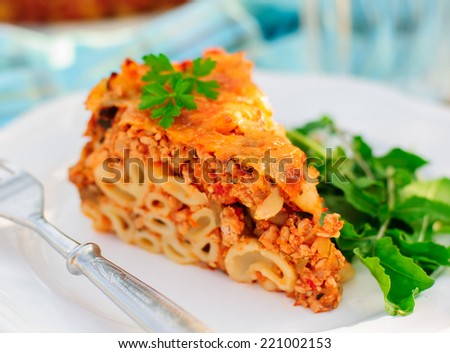 A Piece of Bolognese Pasta Bake, Macaroni Cheese, Minced Meat and Pasta Pie, close up, copy space for your text - stock photo