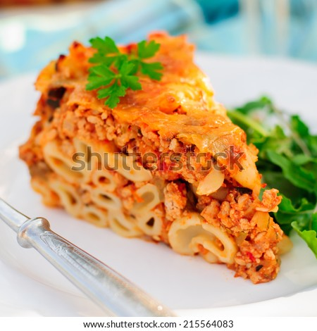 A Piece of Bolognese Pasta Bake, Macaroni Cheese, Minced Meat and Pasta Pie, close up, square - stock photo