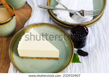 a piece of cheesecake on plate. - stock photo