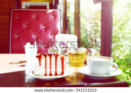 a piece of crepe cake with strawberry sauce and a cup of coffee latte and hot tea with beautiful background - stock photo
