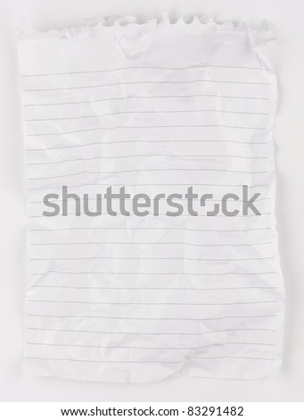 A piece of crumpled and creased lined whited notepaper from a spiral bound notepad. - stock photo